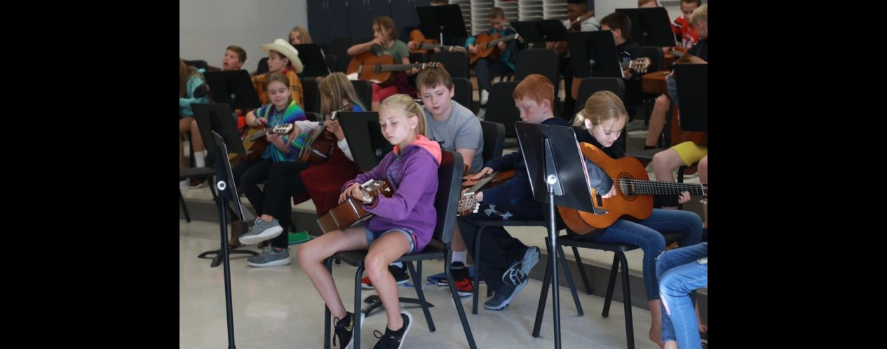 Photograph of 5th Grade Musci students with guitars