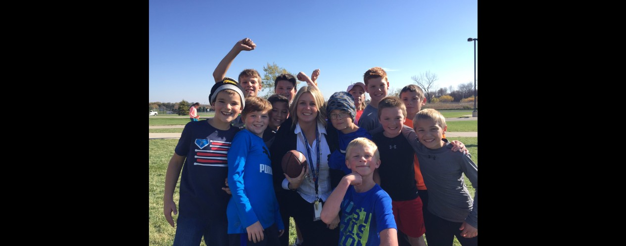 Mrs. Kyllo plays football with 5th Grade boys